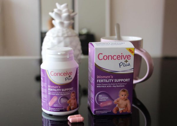 Fertility capsules dietary supplement on table
